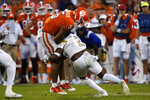 Clemson quarterback D.J. Uiagalelei (5) is hit by Georgia Tech defensive back Tariq Carpenter (2) after a short gain in the second half of an NCAA college football game, Saturday, Sept. 18, 2021, in Clemson, S.C. (AP Photo/John Bazemore)