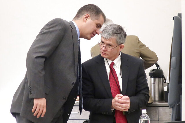 FILE - In this Dec. 12, 2019 file photo, District Judge F. William Cullins, right, of Montgomery County, Kansas, confers with his attorney, Christopher Joseph, during a break in his disciplinary hearing, in Topeka, Kansas. The foul-mouthed Kansas judge who cursed at courthouse employees so often that a trial clerk kept a