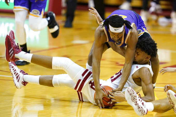 Tennessee Tech's Austin Harvell, top, and Indiana's Jerome Hunter scramble for a loose ball during the first half of an NCAA college basketball game Wednesday, Nov. 25, 2020, in Bloomington, Ind. (AP Photo/Darron Cummings)
