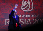 FILE - In this Friday Dec. 1, 2017 file photo former English soccer international Gordon Banks waves as he walks on stage for the 2018 soccer World Cup draw in the Kremlin in Moscow. English soccer club Stoke said Tuesday Feb. 12, 2019 that World Cup-winning England goalkeeper Gordon Banks has died at 81. (AP Photo/Pavel Golovkin, File)
