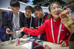 In this Oct. 31, 2019 photo, an exhibitor talks about Huawei smartphones at a Huawei booth at the PT Expo technology conference in Beijing. Chinese tech giant Huawei is racing to develop replacements for Google apps. U.S. sanctions imposed on security grounds block Huawei from using YouTube and other popular Google