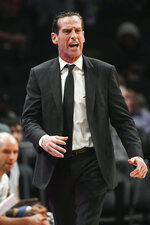 Brooklyn Nets coach Kenny Atkinson shouts to players during the first half of the team's NBA basketball game against the Atlanta Hawks, Wednesday, Dec. 4, 2019 in Atlanta. (AP Photo/John Amis)