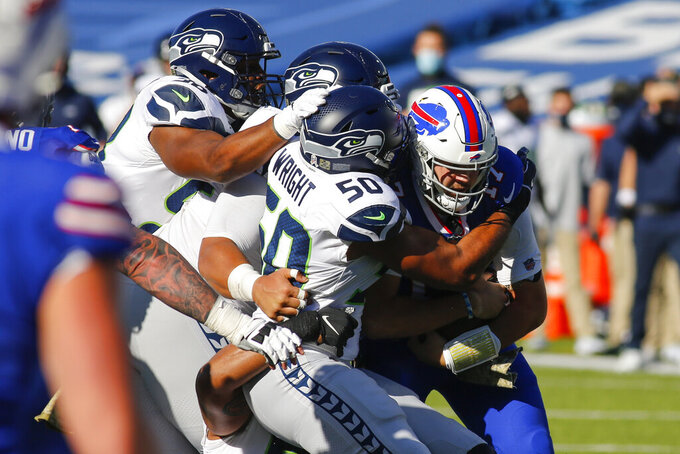 Seattle Seahawks outside linebacker K.J. Wright (50) tackles Buffalo Bills quarterback Josh Allen during the first half of an NFL football game Sunday, Nov. 8, 2020, in Orchard Park, N.Y. (AP Photo/Jeffrey T. Barnes)