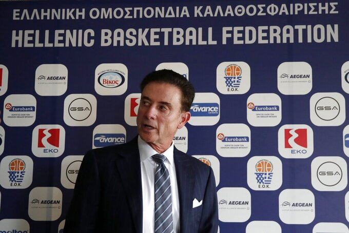 FILE - Greece national basketball team head coach Rick Pitino leaves a press conference in Athens, Greece, in this Monday, Nov. 11, 2019, file photo. Iona coach and Basketball Hall of Famer Rick Pitino is coaching the Greek national team in the Olympic qualifying tournament that starts Tuesday in Victoria, British Columbia. (AP Photo/Thanassis Stavrakis, File)