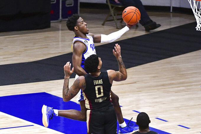 Pittsburgh guard Xavier Johnson drives past Florida State guard Rayquan Evans during the second half of an NCAA college basketball game, Saturday, Feb. 20, 2021, in Pittsburgh. (AP Photo/Fred Vuich)