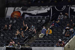 Fans return to the AT&T Center in a limited capacity for an NBA basketball game between the San Antonio Spurs and the Oklahoma City Thunder in San Antonio, Thursday, March 4, 2021. (AP Photo/Eric Gay)
