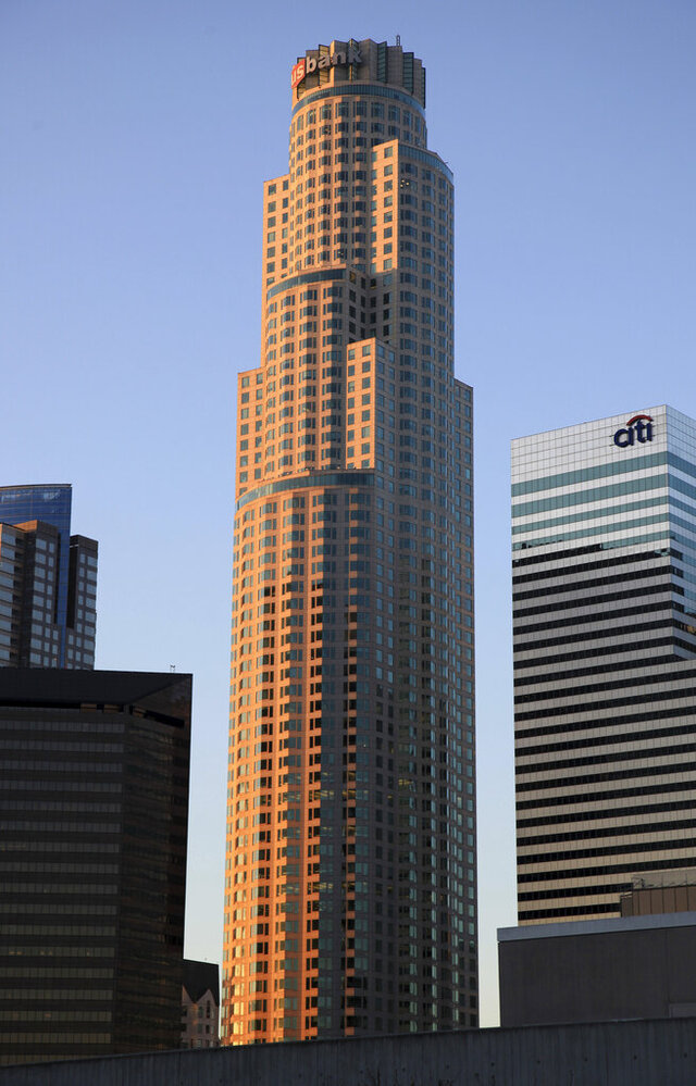 FILE - In this March 12, 2013, file photo, the U.S. Bank Tower building is seen as the sun rises over downtown Los Angeles. The U.S. Bank Tower, one of the tallest buildings in the West and a landmark in downtown Los Angeles, will be sold to the developer of the new World Trade Center in New York. The deal will close in September 2020. (AP Photo/Richard Vogel, File)