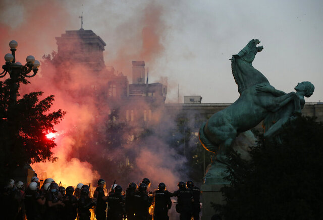 Police clashes with protesters in Belgrade, Serbia, on Wednesday, July 8, 2020. On Wednesday, President Aleksandar Vucic backtracked on his plans to reinstate a coronavirus lockdown in Belgrade after thousands protested the move and violently clashed with the police in the capital. (AP Photo/Darko Vojinovic)