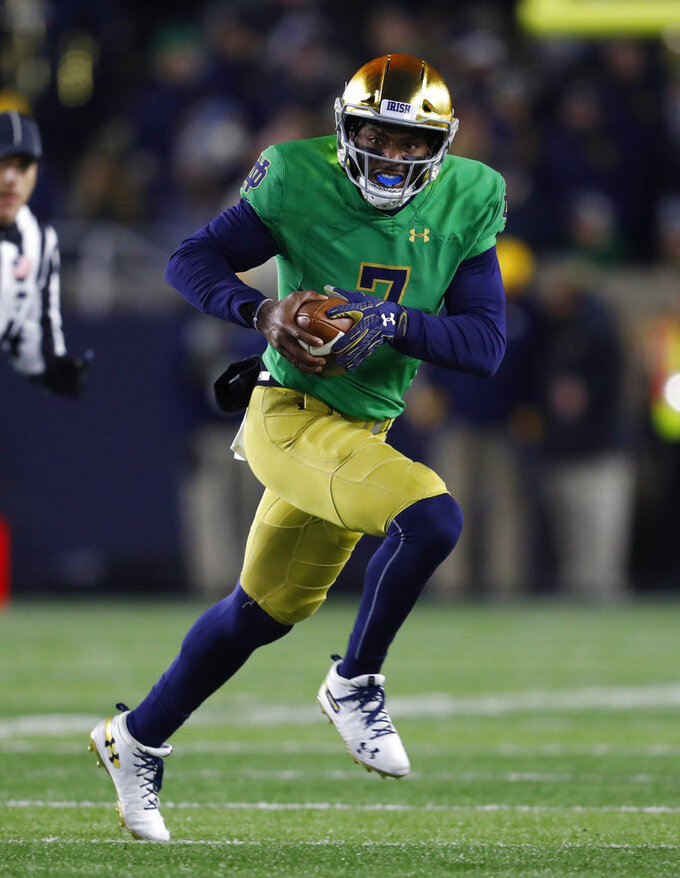 Notre Dame quarterback Brandon Wimbush (7) runs the ball against Florida State in the first half of an NCAA college football game in South Bend, Ind., Saturday, Nov. 10, 2018. (AP Photo/Paul Sancya)