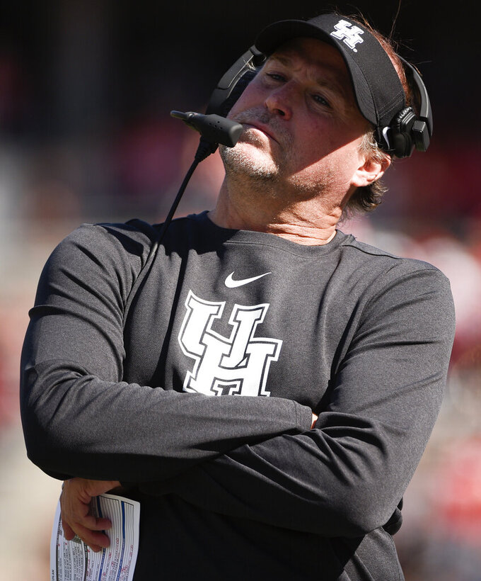 Houston head coach Dana Holgorsen reacts after a Cincinnati touchdown during the first half of an NCAA college football game, Saturday, Oct. 12, 2019, in Houston. (AP Photo/Eric Christian Smith)