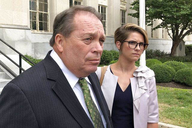 FILE - In this Sept. 12, 2018, file photo, Jerry Lundergan, father of Kentucky Secretary of State Alison Lundergan Grimes, leaves the federal courthouse with his attorney Whitney True Lawson, in Lexington, Ky. Kentucky businessman and Democrat Party stalwart Jerry Lundergan, 73, was sentenced on Thursday, July 16, 2020, to 21 months in prison for making illegal contributions to the failed U.S. Senate campaign of his daughter. (AP Photo/Adam Beam, File)