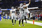 Las Vegas Raiders wide receiver Marcell Ateman (88) celebrates his touchdown catch with quarterback Derek Carr, right, next to tight end Matt Bushman (84) during the second half of a preseason NFL football game against the Los Angeles Rams on Saturday, Aug. 21, 2021, in Inglewood, Calif. (AP Photo/Ashley Landis)