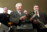 FILE - In this Jan. 17, 2002 file photo, former Baltimore city Mayor Thomas D'Alesandro III, center, Richard W. Slossen, Executive Director of the Maryland Stadium Authority, right, and Baltimore City Coucilman Bob Curran, left, laugh as they look over the contents of an unveiled time capsule in Baltimore. D'Alesandro III, the brother of House Speaker Nancy Pelosi, has died. He was 90. A spokesman for Pelosi said D'Alesandro died Sunday, Oct. 20, 2019. (AP Photo/Gail Burton, File)