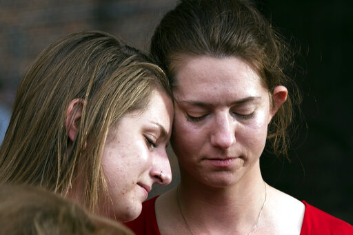 Summerleigh Winters Geimer, left, and her sister Montana Winters Geimer, daughters of Wendi Winters, a community beat reporter who died in the Capital Gazette newsroom shooting, react during a press conference following the sentencing verdict of Jarrod W. Ramos, Tuesday, Sept. 28, 2021, in Annapolis, Md.   Ramos was sentenced on Tuesday to more than five life terms without the possibility of parole, according to prosecutors. (AP Photo/Jose Luis Magana)