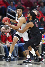North Carolina Central guard Deven Palmer (5) attempts to tip the ball away from Louisville's Jordan Nwora during the first half of an NCAA college basketball game in Louisville, Ky., Sunday, Nov. 17, 2019. (AP Photo/Timothy D. Easley)