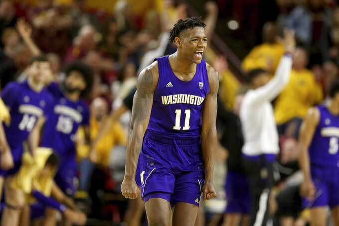 Washington's Nahziah Carter (11) celebrates a3-pointer against Arizona State late in the second half of an NCAA college basketball game Thursday, March 5, 2020, in Tempe, Ariz. Washington won 90-83. (AP Photo/Darryl Webb)