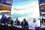 Etihad CEO Tony Douglas, left, Boeing Commercial Airplanes president and CEO Stanley A. Deal, second left, Boeing Global Services President and CEO Ted Colbert, third left and Etihad COO Mohammad al-Bulooki, right, attend a news conference at the Dubai Airshow in Dubai, United Arab Emirates, Monday, Nov. 18, 2019. Abu Dhabi's flagship carrier Etihad said Monday it had partnered with Boeing Co. to launch what they say will be one of the world's most fuel-efficient long haul airplanes as the company seeks to save costs on fuel and position itself as a more environmentally-conscious choice for travelers. (AP Photo/Jon Gambrell)