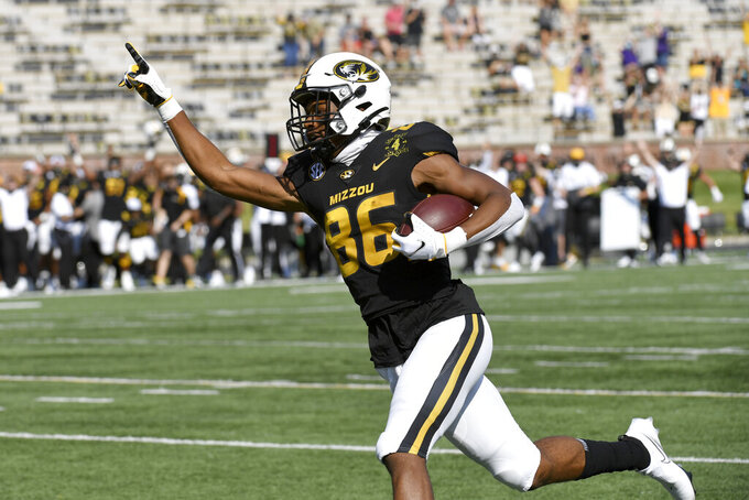 Missouri wide receiver Tauskie Dove celebrates as he runs into the end zone after catching an 86-yard pass for a touchdown during the first half of an NCAA college football game against the LSU Saturday, Oct. 10, 2020, in Columbia, Mo. (AP Photo/L.G. Patterson)