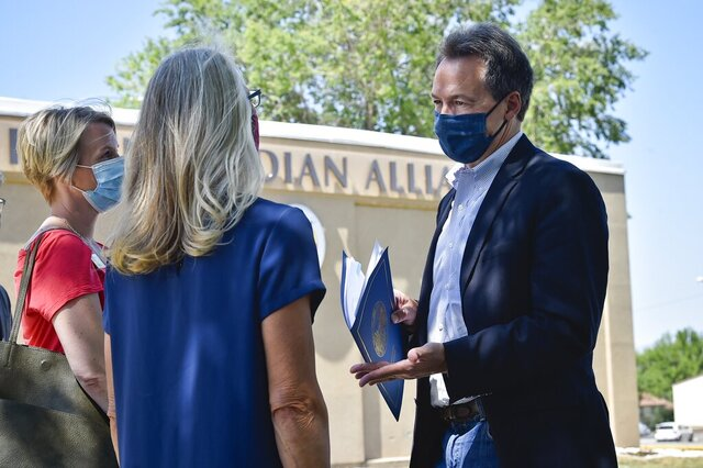 FILE - In this July 30, 2020, file photo, Gov. Steve Bullock holds a news conference announcing that $1 million in Coronavirus Relief Funds will be available to rural and safety net health care providers outside the Leo Pocha Memorial Clinic in Helena, Mont. Montana health officials reported a record number of COVID-19 cases on Friday, Sept. 18, 2020 a day after breaking a record that has stood since July. But a state health official said that cases aren't necessarily on the rise. The state confirmed 224 cases of COVID-19 on Friday, a day after setting a record of 221 cases. (Thom Bridge/Independent Record via AP, File)