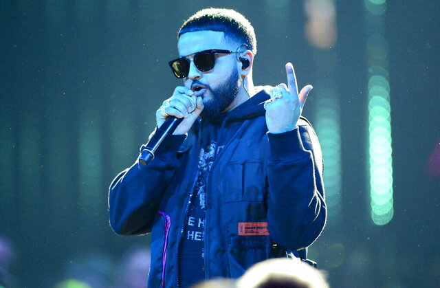 "FILE - This March 17, 2019 file photo shows Nav performing at the Juno Awards in London, Ontario, in Canada. Nav's latest ""Good Intentions"" project debuted this week at No. 1 on the Billboard 200 albums chart. (Frank Gunn/The Canadian Press via AP, File)"