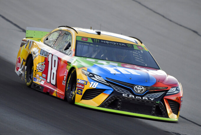 Kyle Busch heads into Turn 1 during practice for the NASCAR Cup Series auto race at Texas Motor Speedway in Forth Worth, Texas, Friday, Nov. 1, 2019. (AP Photo/Larry Papke)