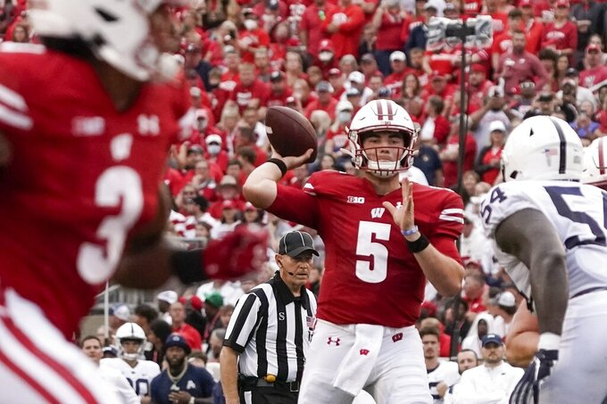 Wisconsin's Graham Mertz throws a pass during the first half of an NCAA college football gameagainst Penn State Saturday, Sept. 4, 2021, in Madison, Wis. (AP Photo/Morry Gash)