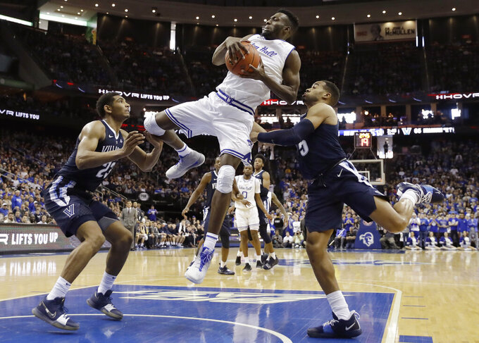 Seton Hall forward Michael Nzei (1) pulls down a rebound as Villanova forward Jermaine Samuels (23) and Villanova guard Phil Booth (5) defend him during the second half of an NCAA college basketball game, Saturday, March 9, 2019, in Newark, N.J. Seton Hall defeated Villanova 79-75. (AP Photo/Kathy Willens)