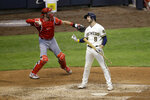 Milwaukee Brewers' Ryan Braun (8) reacts after striking out during the sixth inning of the first baseball game of a doubleheader against the Cincinnati Reds, Thursday, Aug. 27, 2020, in Milwaukee. (AP Photo/Aaron Gash)