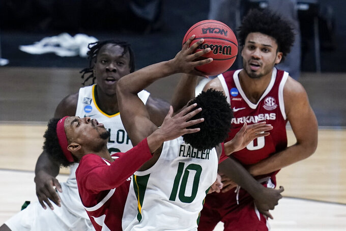 Baylor guard Adam Flagler (10) drives on Arkansas guard Jalen Tate, left, during the second half of an Elite 8 game in the NCAA men's college basketball tournament at Lucas Oil Stadium, Monday, March 29, 2021, in Indianapolis. (AP Photo/Michael Conroy)