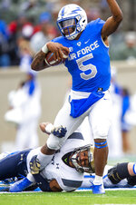 Air Force quarterback Donald Hammond III (5) escapes with the football against Navy  during an NCAA college football game at Falcon Stadium at the U.S. Air Force Academy, Saturday Oct. 6, 2018, in Colorado Springs, Colo.  (Dougal Brownlie,/The Gazette via AP)