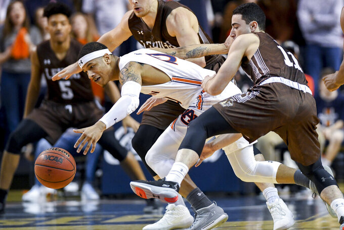 Lehigh guard Jordan Cohen (11) and Auburn guard Samir Doughty (10) chase down the ball during the first half of an NCAA college basketball game Saturday, Dec. 21, 2019, in Auburn, Ala. (AP Photo/Julie Bennett)