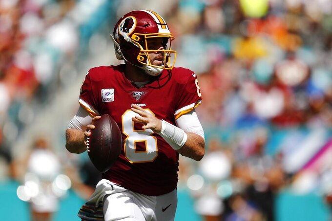 Washington Redskins quarterback Case Keenum (8) looks to pass, during the first half at an NFL football game against the Miami Dolphins, Sunday, Oct. 13, 2019, in Miami Gardens, Fla. (AP Photo/Brynn Anderson)
