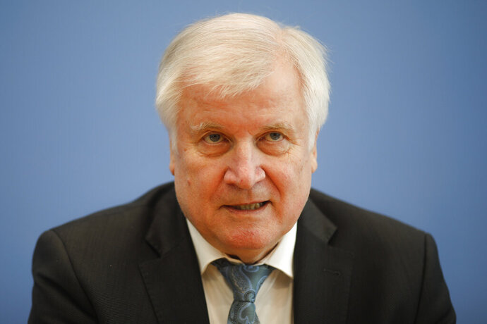 German Interior Minister Horst Seehofer attends a news conference on a package of measures against far-right extremism and anti-Semitism in Berlin, Germany, Wednesday, Oct. 30, 2019. Chancellor Angela Merkel's Cabinet signed off Wednesday on the tightening of gun laws, stricter persecution of hate crime online, and more financial support for initiatives fighting anti-Semitism and far-right extremism. (AP Photo/Markus Schreiber)