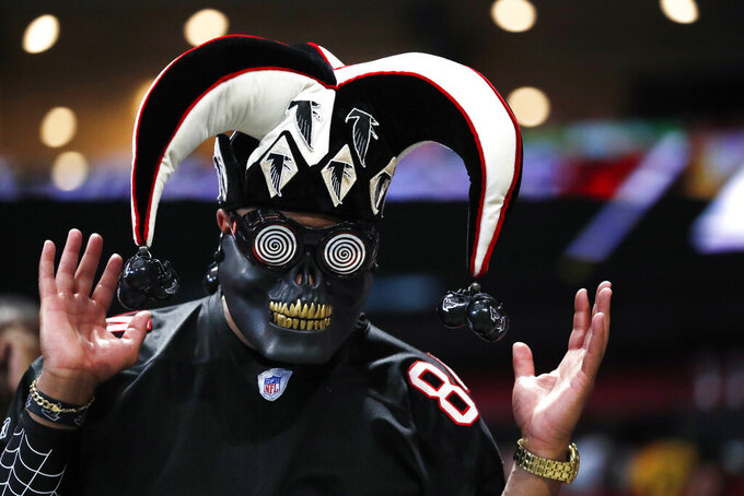 An Atlanta Falcons fan watches play during the first half of an NFL football game between the Atlanta Falcons and the Tennessee Titans, Sunday, Sept. 29, 2019, in Atlanta. (AP Photo/John Bazemore)