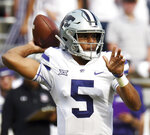 Kansas State quarterback Alex Delton throws downfield for a completion against TCU during the second quarter of an NCAA college football game Saturday, Nov. 3, 2018, in Fort Worth, Texas. (Bob Haynes/Star-Telegram via AP)