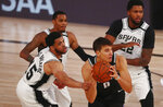 Sacramento Kings guard Bogdan Bogdanovic (8) is fouled by San Antonio Spurs guard Quinndary Weatherspoon (15) during the second half of an NBA basketball game Friday, July 31, 2020, in Lake Buena Vista, Fla. (Kim Klement/Pool Photo via AP)