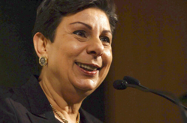 """FILE - In this Nov. 6, 2003, file photo, Palestinian legislator Hanan Ashrawi smiles as she receives the 2003 Sydney Peace Prize in Sydney. Ashrawi, a veteran senior official in the Palestine Liberation Organization, announced her resignation on Wednesday, Dec. 9, 2020, saying the Palestinian political system needs """"renewal and reinvigoration."""" (AP Photo/Mick Tsikas, Pool, File)"""