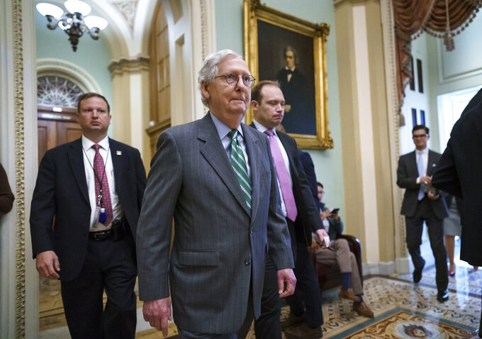Senate Minority Leader Mitch McConnell, R-Ky., returns to the chamber after a news conference to criticize the Democrat push to pass a voting rights bill, at the Capitol in Washington, Thursday, June 17, 2021. (AP Photo/J. Scott Applewhite)