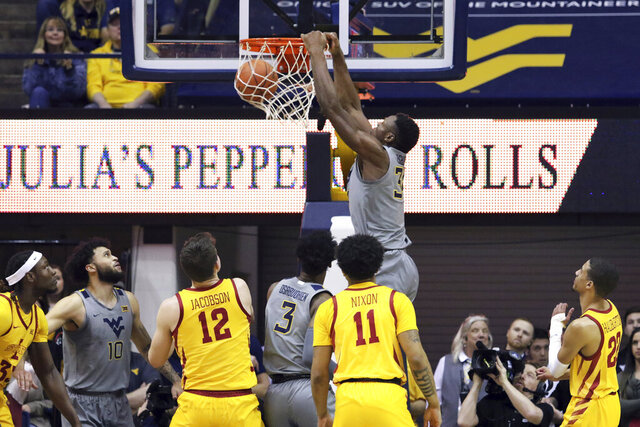 West Virginia forward Oscar Tshiebwe (34) dunks the ball during the first half of an NCAA college basketball game against Iowa State Wednesday, Feb. 5, 2020, in Morgantown, W.Va. (AP Photo/Kathleen Batten)