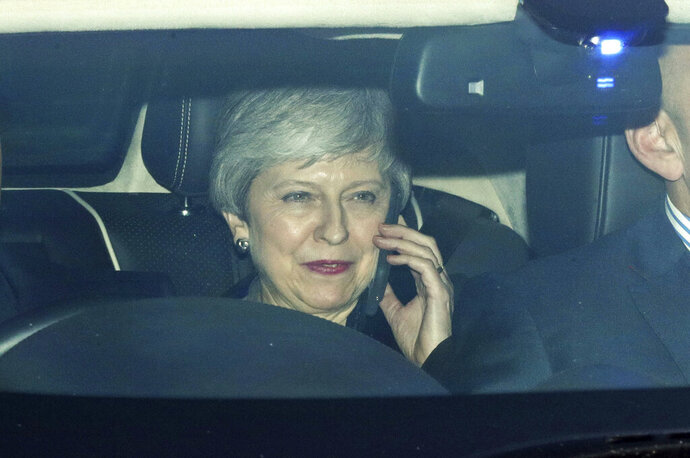 Britain's Prime Minister Theresa May leaves parliament's Carriage Gates in Westminster, London, Tuesday May 14, 2019. (Aaron Chown/PA via AP)