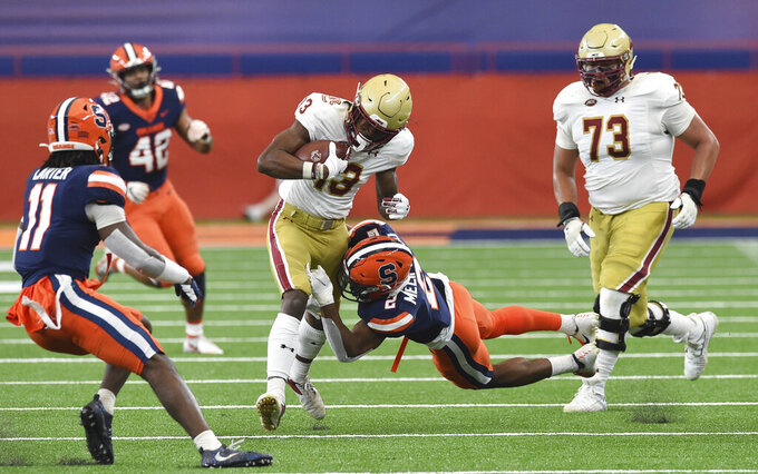 Boston College wide receiver Jehlani Galloway (13) is tackled by Syracuse defensive back Ifeatu Melifonwu (2) during the first half of NCAA college football game, Saturday, Nov. 7, 2020, at the Carrier Dome in Syracuse, N.Y. (Dennis Nett/The Post-Standard via AP)