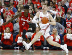 Ohio State's Justin Ahrens, right, passes the ball in front of Nebraska's Cam Mack during the first half of an NCAA college basketball game Tuesday, Jan. 14, 2020, in Columbus, Ohio. (AP Photo/Jay LaPrete)