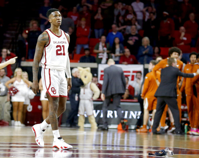 Oklahoma's Kristian Doolittle (21) walks off the court for a timeout after Texas made a go-ahead 3-point basket during an NCAA college basketball game in Norman, Okla., Tuesday, March 3, 2020. (Sarah Phipps/The Oklahoman via AP)