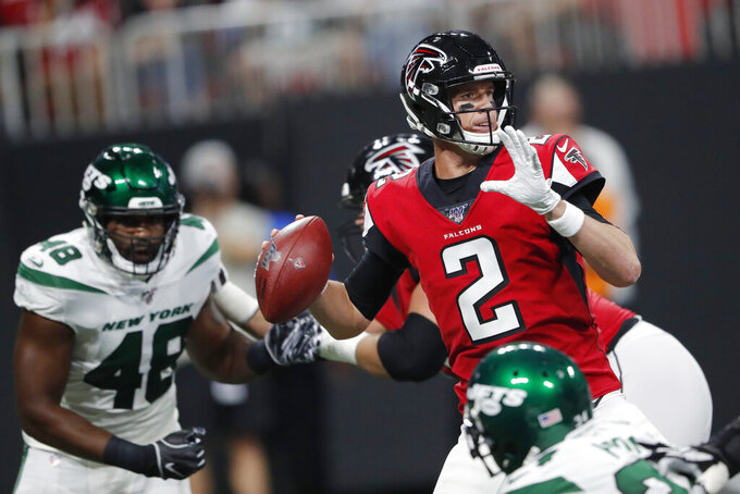 Atlanta Falcons quarterback Matt Ryan (2) works in the pocket during the first half an NFL preseason football game against the New York Jets, Thursday, Aug. 15, 2019, in Atlanta. (AP Photo/John Bazemore)
