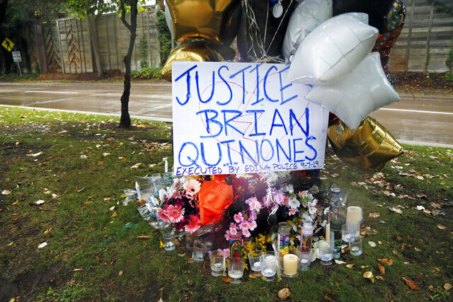 FILE - In this Sept 9, 2019, file photo, a memorial stands in Richfield, Minn. near where police shot and killed Brian J. Quinones-Rosario who had streamed himself live on Facebook during a police chase after he apparently emerged from his car holding a knife and refused their commands to drop it. The Hennepin County Attorney's Office will not file criminal charges against Richfield or Edina police officers for the fatal shooting of Quinones-Rosario, Hennepin County Attorney Mike Freeman announced Monday, Feb. 10, 2020. (AP Photo/Jim Mone, File)