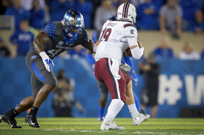 Kentucky linebacker Josh Allen (41) nears South Carolina quarterback Jake Bentley (19) on a sack during the second half of an NCAA college football game in Lexington, Ky., Saturday, Sept. 29, 2018. (AP Photo/Bryan Woolston)
