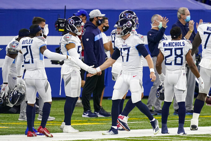 Tennessee Titans quarterback Ryan Tannehill (17) comes to the sideline after scoring a touchdown against the Indianapolis Colts in the first half of an NFL football game in Indianapolis, Sunday, Nov. 29, 2020. (AP Photo/Darron Cummings)