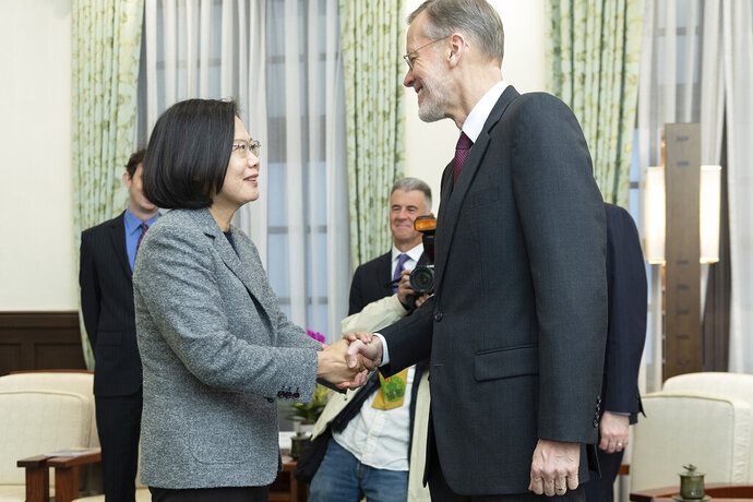 In this photo released by the Taiwan Presidential Office, William Brent Christensen, director of the American Institute in Taiwan at right meets with Taiwan President Tsai Ing-wen, at left in the Presidential Office in Taipei, Taiwan. The Taiwanese president sat down with the top American official in Taipei on Sunday, one day after her landslide victory over challenger Han Kuo-yu of the opposition Nationalist Party. (Taiwan Presidential Office via AP)