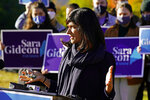 Sara Gideon, Democratic candidate for U.S. Senate, speaks in front of supporters after casting her absentee ballot, Wednesday, Oct. 14, 2020, in Freeport, Maine. Gideon, the speaker of the Maine House, is challenging incumbent Republican Sen. Susan Collins. (AP Photo/Robert F. Bukaty)