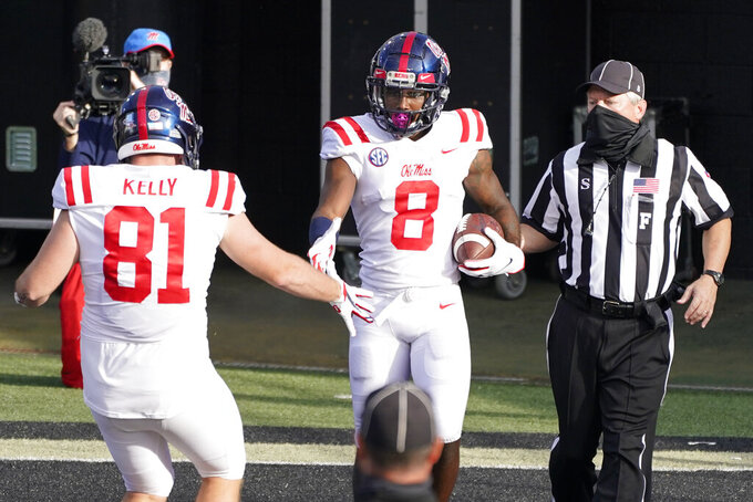 Mississippi wide receiver Elijah Moore is congratulated by Casey Kelly (81) after Moore scored a touchdown against Vanderbilt in the first half of an NCAA college football game Saturday, Oct. 31, 2020, in Nashville, Tenn. (AP Photo/Mark Humphrey)